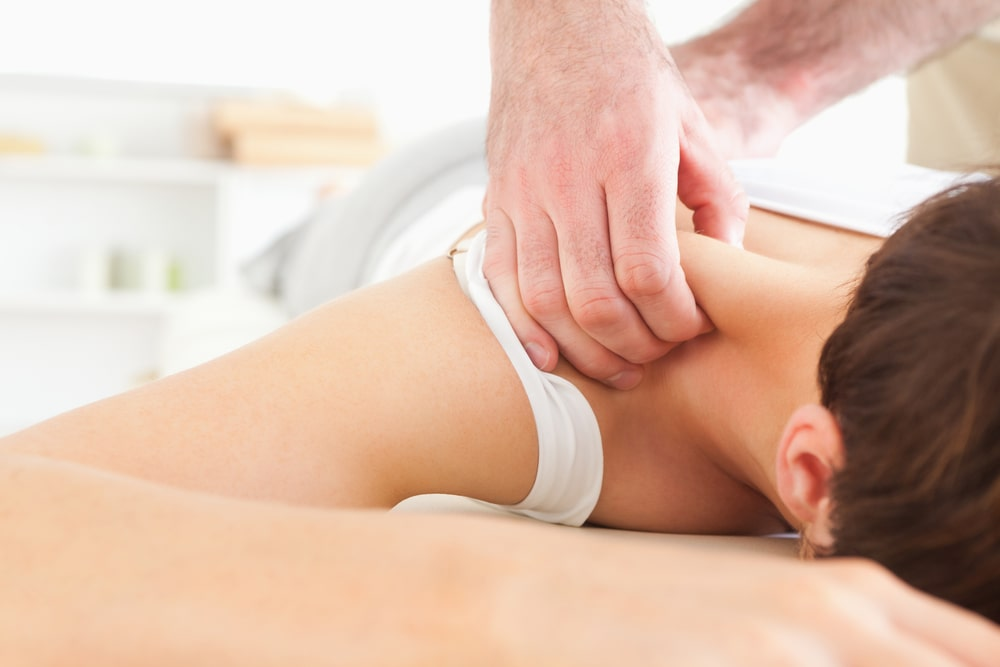 Woman Getting Neck Massage From Physical Therapist