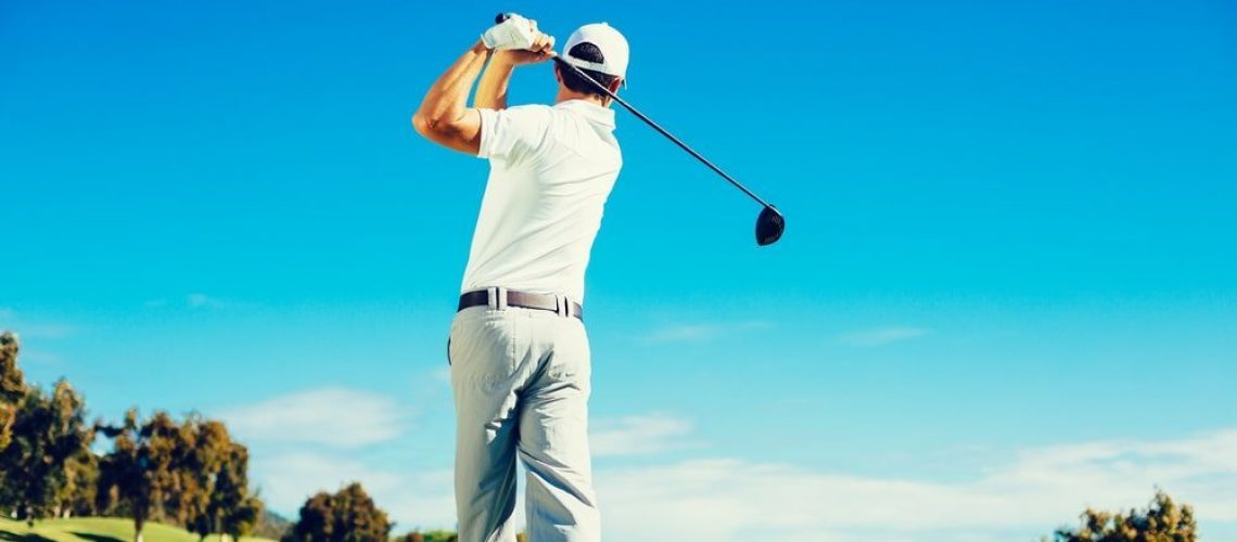 man golfing after chiropractic care